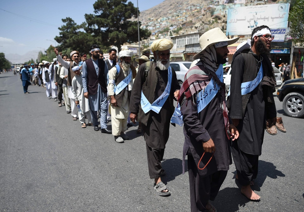 Afghan peace marchers tired and war-weary after Taliban ends truce