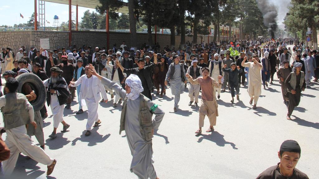 Afghan attempt to rein in warlords faces backlash as violent protests spread