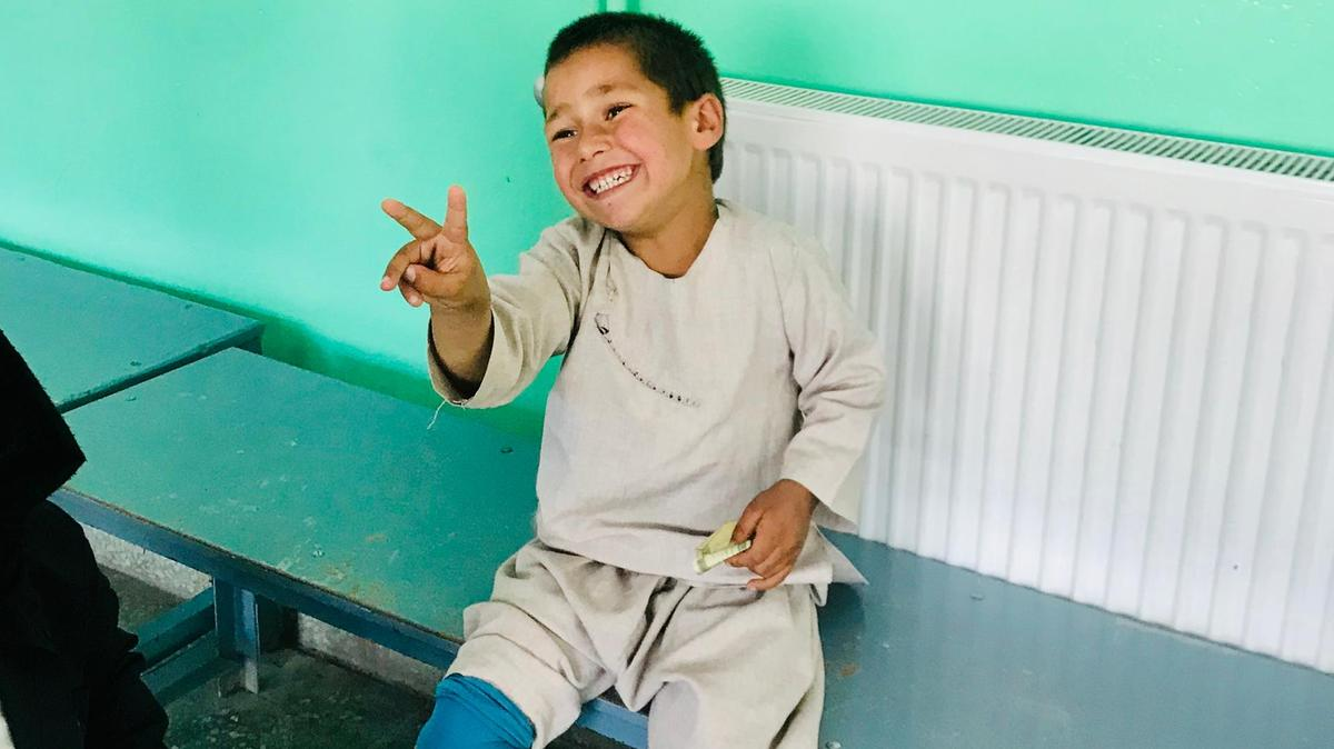 Afghan boy dances for joy with new prosthetic leg
